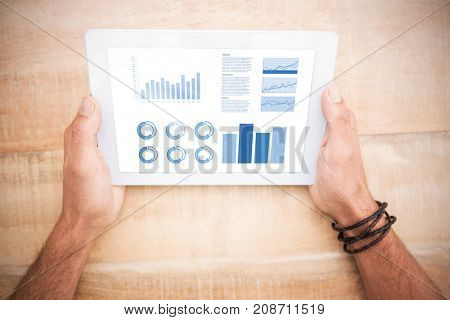 Blue graphics on white background against hands holding blank screen tablet