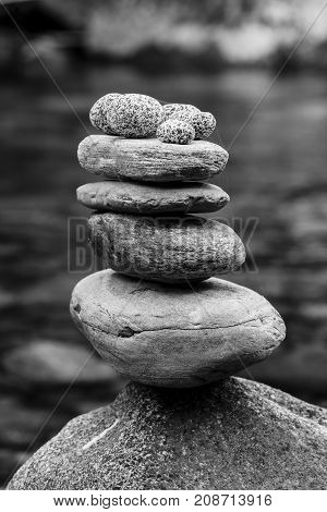 Well balanced rock cairn. A black and white image of a well balanced rock cairn.