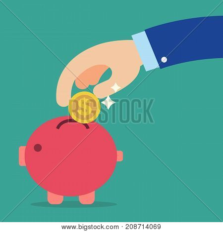 Business hand holding coin into red piggy bank with green background.Saving money concept