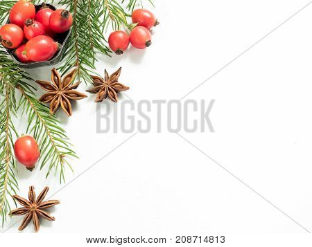 Christmas decorations on a white background berries rose hips stars fir branches