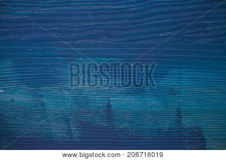 Blue wood texture. Navy blue wood background. Closeup view of blue wood texture and background. Abstract background and texture for designers. Texture of vintage handmade table. Rustic table.