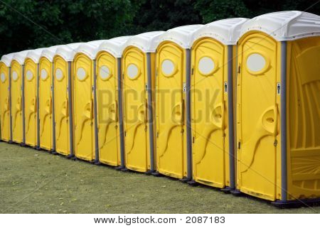Row Of Yellow Portable Toilets