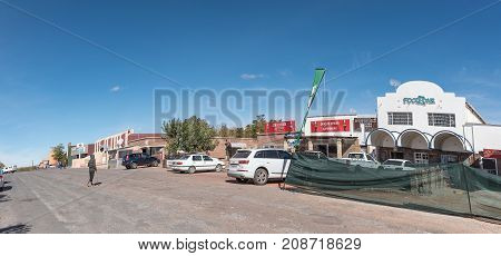 GROBLERSHOOP SOUTH AFRICA - JUNE 11 2017: A street scene with businesses and vehicles of Groblershoop a town in the Northern Cape Province of South Africa