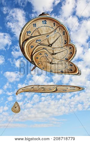 Liquid and flexible time concept.Surreal Alarm clock transforming and thawing on blue cloudy sky background.