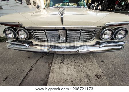 Leland, Michigan, USA - October 1, 2017: Front view of a classic 1960's Dodge Imperial. Manufactured by Chrysler, the Imperial was marketed as a luxury car to compete with the Lincoln and Cadillac.