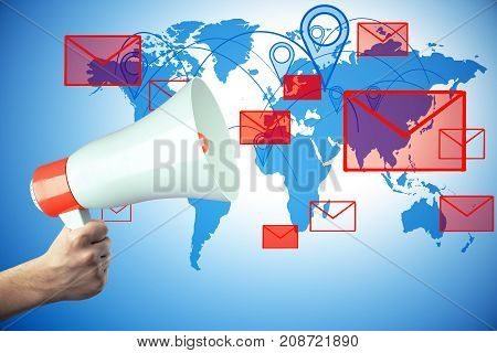 Hand holding megaphone on abstract blue background with map and letter icons. E-mail marketing concept. 3D Rendering