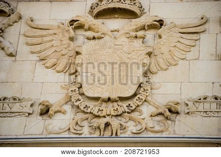 Details of stone sculptures of the facade of the University of Alcalá de Henares. Madrid, Spain