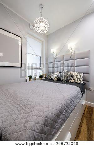Small modern bedroom interior design in gray finishing