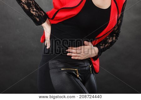Woman In Red Shirt Having Stomach Ache