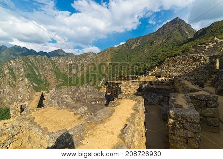 Machu Picchu Illuminated By The Last Sunlight. Wide Angle View From Below Over The Glowing Terraces