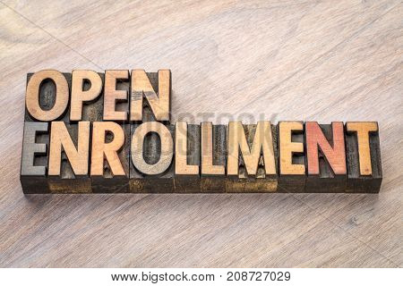 open enrollment word abstract in vintage letterpress wood type