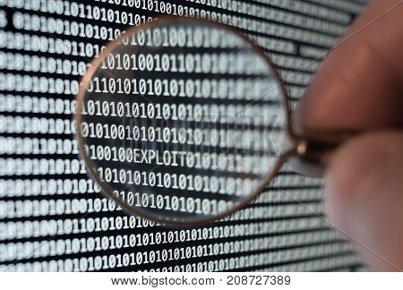Exploit found with magnifying glass in binary code