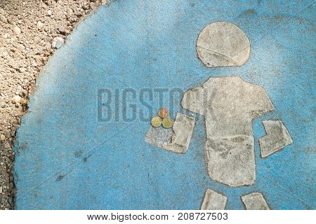 Foot walk path way sign on concrete holding money coins