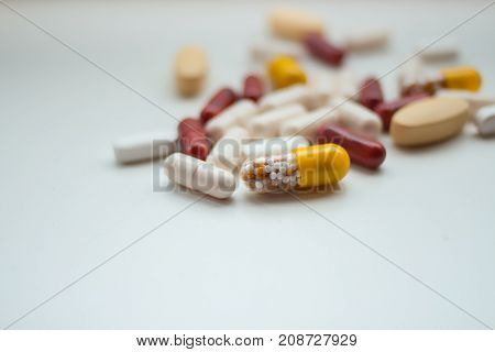 Assorted pills and tablets isolated on white background