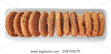 Delicious oatmeal cookies with raisins in pack on white background