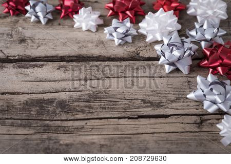 Packaging Bows On Wooden Background