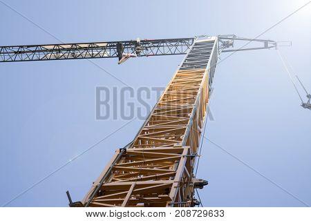 Construction site crane low angle clear blue sky