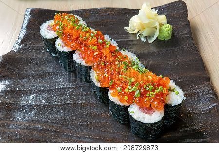 Raw Fish Yellowtail and Tuna Sushi Roll with Fish Eggs Roe with Wasabi and Ginger