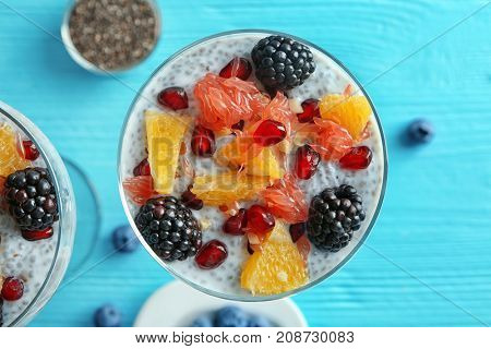 Glass with delicious chia seed pudding on table, close up