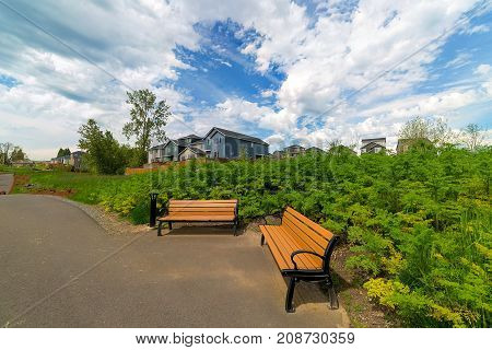 Benches in the park along hiking trail in Happy Valley Oregon residential subdivision neighborhood