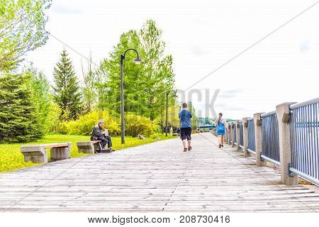 Saguenay, Canada - June 3, 2017: Sidewalk Terrace Boardwalk In Downtown Summer City Park In Quebec W
