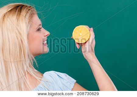 Girl Holding Lemon Citrus Fruit