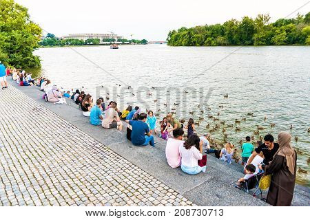 Washington Dc, Usa - August 4, 2017: People Sitting On Steps In Georgetown Waterfront Park On Riverf