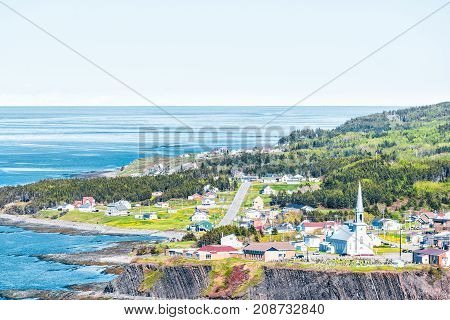 Aerial Cityscape Skyline View Of Grande-vallee Village Town And Saint Lawrence River Gulf During Day