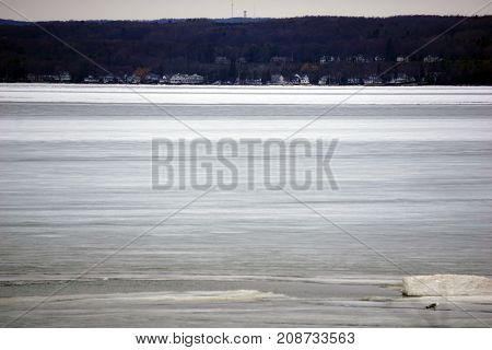 A view of the frozen Little Traverse Bay, and Harbor Springs, from the beach in Bay View, Michigan, during March.