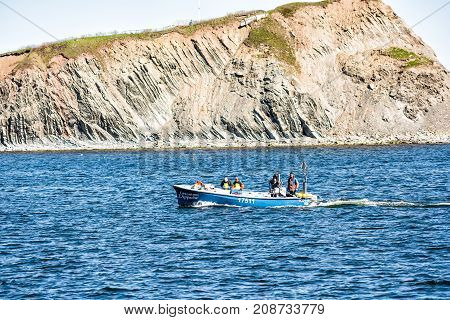 Perce, Canada - June 6, 2017: Fishing Boat With Sign Swimming By Rocher Perce Rock And Bonaventure I