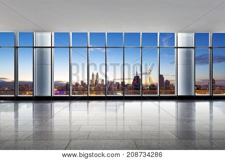 empty office and cityscape of kuala lumpur in cloud sky