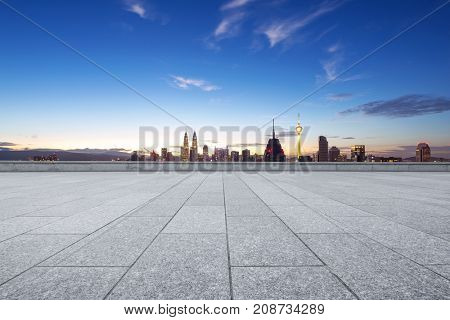 empty marble floor and cityscape of kuala lumpur at twilight
