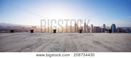 empty concrete floor and cityscape of kuala lumpur with sunbeam