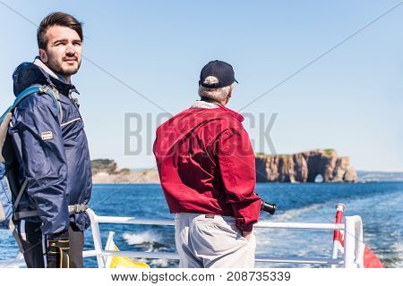 Perce, Canada - June 6, 2017: People Tourists On Boat Tour Taking Photo Picture Of Rocher Perce Rock
