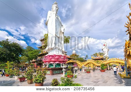 Dong Nai, Vietnam - October 8th, 2017: Bodhisattva architecture in temple afternoon with sun through cloud create auspicious buddha. A peacefull place to calm your mind and soul in Dong Nai, Vietnam