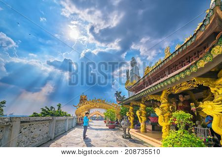 Dong Nai, Vietnam - October 8th, 2017: Buddhists Praying the buddha in the ancient architectural pagoda with beautiful statues depicting religious spiritual culture in Dong Nai, Vietnam.