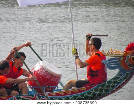 Taipei Taiwan, 20 June 2015: Closeup view of a drum and drummer at Dragon boat festival race on tamsui river in Taipei