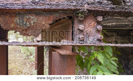 weathered rusty detail showing a et away steel girder