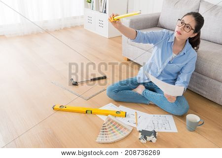 Housewife Sitting In Living Room Wooden Floor