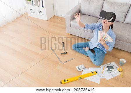 Happy Pretty Female Designer Using Virtual Reality
