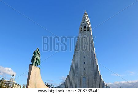Sep 8, 2017, Reykjavi?k,  Iceland. Leif Eriksson Statue (a gift from US to Iceland) and the Iconic Hallgrimskirkja or the church of Hallgrimur. A Lutheran Church. On a warm summer blue sky day.