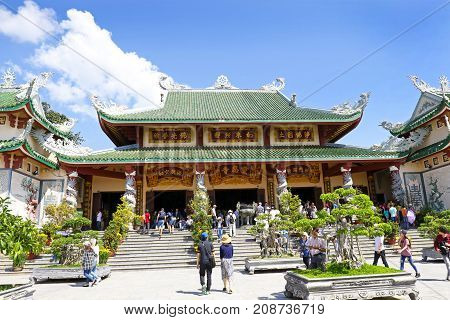 DANANG (DA NANG) VIETNAM - FEBRUARY 5, 2017: Worshippers at Linh Ung Temple, Pagoda with blue sky background. Traditional Buddhist temple. Danang is a popular tourist destination of Asia