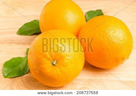 Fresh Navel orange fruit on wooden background, healthy fruit