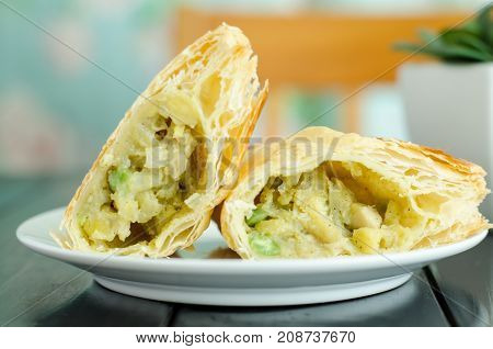 Breakfast,puff pastry pie with curry chicken on white dish