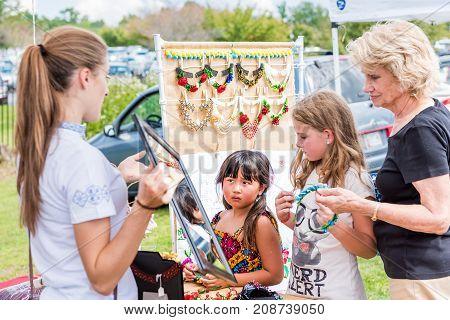 Silver Spring, Usa - September 16, 2017: Girls Buying Ukrainian Slavic Beauty Bead Traditional Neckl