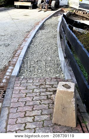 An image of a sidewalk construction - work
