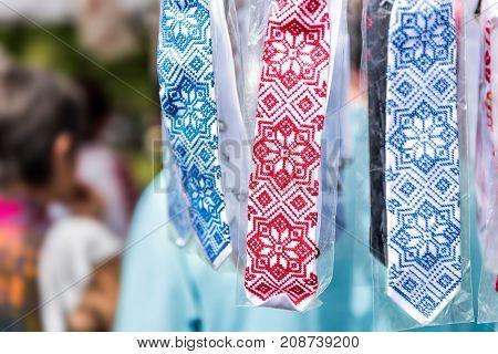 Display Of Embroidered Ukrainian Slavic Men's Traditional Ties Embroidery In Outdoor Flea Market