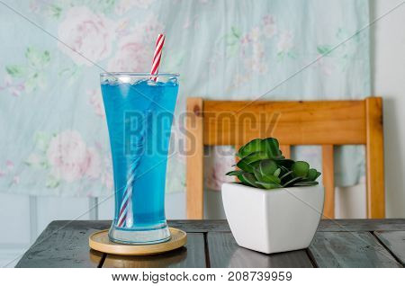 Ice blue drink in the glass on table for drink, summer drink