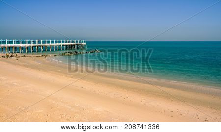 MESSILA, KUWAIT - SEPTEMBER 3, 2015 - A pier on the beach in Messila overlooking The Gulf Sea on September 3, 2015, in Kuwait.