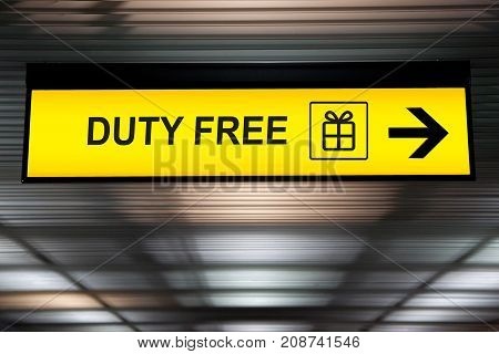 Duty Free shopping sign hanging from ceiling from airport terminal
